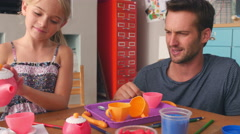 Father Having Tea Party With Daughter In Bedroom Stock Footage