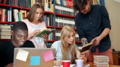 Cheerful students in library Stock Footage