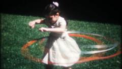 2217 - mom & the girls with Hula Hoops at home - vintage film home movie Stock Footage