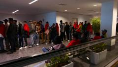 Many Indian people wait in line for boarding, delayed flight - stock footage