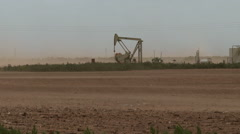 Oil pump in Texas blowing sand Stock Footage