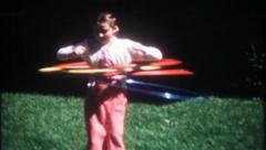 2216 - young girls Hulu Hoop in suburbia - vintage film home movie Stock Footage