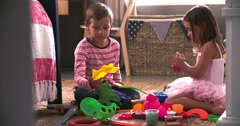 Two Children Playing With Toys In Bedroom Together Stock Footage