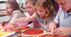Family Making Pizza In Kitchen Together Stock Footage
