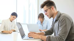 Start-up businesspeople sharing working space Stock Footage