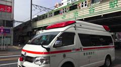 Tokyo Ambulance Parked Street Train Passes On Overpass Shibuya Tokyo Stock Footage