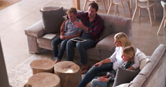 Overhead View Of Family Sitting On Sofa Watching Television Arkistovideo