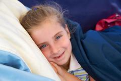 Blond kid girl tired relaxed smiling indented - stock photo