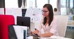 Businesswomen Working At Desks In Modern Open Plan Office - stock footage