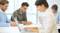 Businesswoman working on laptop, shared workspace Stock Footage