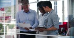People Having Informal Meeting In Modern Open Plan Office - stock footage