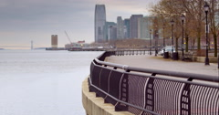 A man runs a park path along the Hudson River in Hoboken - stock footage