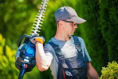 Garden Trimming Works. Professional Gardener - stock photo