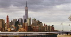 The downtown Manhattan skyline as seen from a park path along the Hudson River Stock Footage