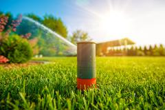Lawn Sprinkler in Action. - stock photo