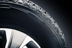 Off Road Tire and Alloy Wheel Closeup Photo. Stock Photos