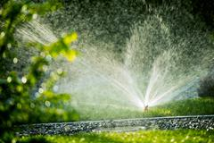 Automatic Grass Watering Systems. Stock Photos