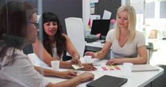 Businesswomen Having Meeting In Open Plan Office - stock footage