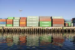 Stacked Shipping Containers on Dock Stock Photos
