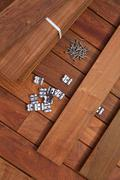 Ipe deck wood installation screws clips fasteners - stock photo