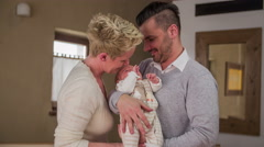 Young attractive parents with newborn child 4K - stock footage