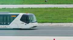 Airport passenger bus driving on runway Stock Footage