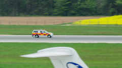Security car driving fast on airport runway  Stock Footage