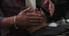 Male Barber Preparing Client For Shave In Shop Stock Footage