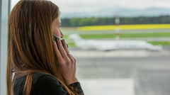 Person make a call at airport Stock Footage