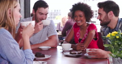 Group Of Friends Sitting In Coffee Shop Chatting - stock footage