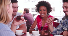 Group Of Friends Sitting In Coffee Shop Chatting Stock Footage
