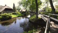 Tourists in boats on the canal of the village of Giethoorn Stock Footage
