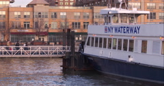 Morning commuters boarding a NY Waterways ferry - stock footage