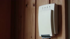 4K Setting Up Home Alarm System by the Control Unit 1 Stock Footage
