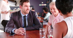 Three Businesspeople Having Working Lunch In Restaurant Stock Footage