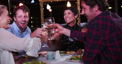 Stock Video Footage of Group Of Mature Friends Enjoying Meal At Rooftop Restaurant