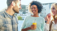 Group Of Friends Relaxing Together At Rooftop Bar Stock Footage