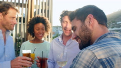 Group Of Friends Relaxing Together At Rooftop Bar - stock footage