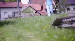 Pulling wheelbarrow down the hill 4K Stock Footage