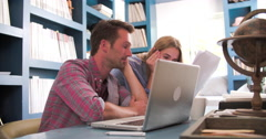 Worried Couple At Desk In Home Office Looking At Bills - stock footage
