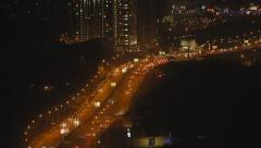 Light traffic on the road of big city at night, cars, lights - stock footage