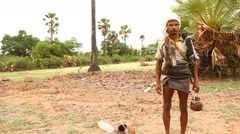 Indian Toddy collection man Stock Footage