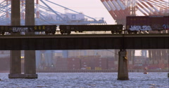 Cargo train passing over the Newark Bay Bridge Stock Footage