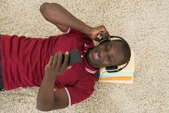 High Angle View Of African Man Listening Music Or Audiobook Stock Photos