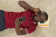 High Angle View Of African Man Listening Music Or Audiobook - stock photo