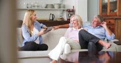 Parents With Adult Offspring Using Digital Devices At Home Stock Footage