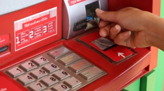 hand using ATM Machine, Asia - stock footage