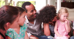 Group Of Families At Home On Patio Talking Together Stock Footage