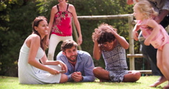 Group Of Families Playing In Garden Together - stock footage