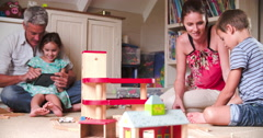 Parents And Children Playing With Toys In Bedroom Stock Footage